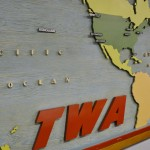 Opening sign once hanging in the TWA headquarters lobby showing intercontinental flight destinations, which shows Kansas City positioned directly in the middle!