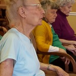 Pat Westman, Corinne Hartnett, and Lorene Rockers do some deep breathing and meditation to end their stretching period. Very relaxing!