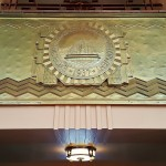 The gold gilded commemorative plaque dedicates the buildings finishing in the grand hall.