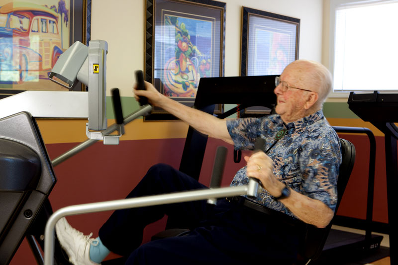 Resident exercising in the community gym