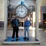 Associate Jason Barrett and Resident Charles Elias pose under the clock for a picture together. (Picture taken by Resident Dorothy Erickson)
