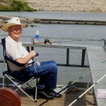 Resident Chuck Couch has both poles in the water and is attentively waiting for a bite!