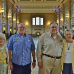 The gang poses in the lobby for a group picture. (Left-to-Right) Resident Dorothy Frederick, Associate Donn Blystone, resident couple Bill and Beverly Fann. Each of the residents shared their own personal story and experiences at The Station, and they all agreed,