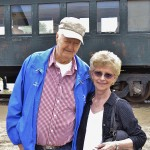 Residents Jim and Carol Tracy pose for a picture in front of our Pullman car.