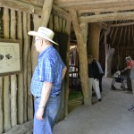 Resident Chuck Couch reads about how all of the parts of the American Bison were used in the creation of the hut enclosures, and even in the mobile structures like the teepees.