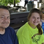 Resident Daryel Cornett with granddaughter Taylor and resident Yoko Rowland taking some rest and relaxation in the shade of the tram station.