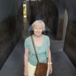 Resident Dorothy Erickson enjoys the cool mist of the waterless-waterfall.