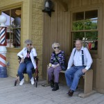 (Left-To-Right): Residents Pat Brown, Louise Humphreys, and Ralph Ireland waiting outside the barber shop.