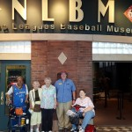 The gang is standing out in front of the entrance to the Negro League Baseball Museum.