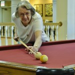 Resident Barbara Tice is about to sink the 9 ball to win the game!
