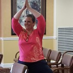 Our Executive Director, Desiree Rogers, stretches for some advanced yoga techniques! I believe this is called the lotus position.