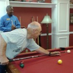 Resident Earl Davis sinks the 5 ball in the corner pocket to advance on the 6 ball!