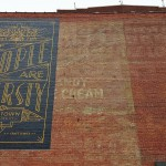 Hand painted signage for the distillery adorns the old bricks of this historic building.