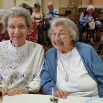 (Left-to-Right): Betty Jaeger and Ruth Ann Bullard are having a blast planting their flowers.