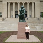 Margaret Gill poses with the Rodin sculpture, The Thinker!