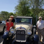 As it would be, the residents got to pose by a Ford Model