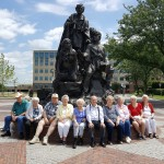 The group gathers for a picture at the Lewis and Clark Expedition statue at Clark's Point in the west-end of Kansas City, MO.