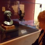 Alta Short looks face-to-face with Pompeii nobility busts.