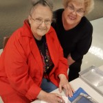 Residents Marsha Leizer (Right) and Mary Louise Taylor (Left) wring their paper out to dry.
