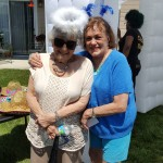 June Higgins (Left) and Margaret Henning (Right) get dressed up to take some pictures in the flash cube photo booth.