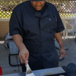 Quincy Davis prepares some delicious hamburgers on the grill for us!