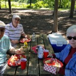 Ted Scott (Left), Rene Comtois (Back), and Dorothy Short (Right) enjoy some picnic fare too...Ted was just as excited about the chips at Louise!