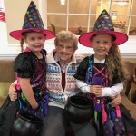 Resident, Aldine Schulze poses with her great granddaughters...they have been participating in our annual safe since they were just knee high to a grasshopper...they enjoy the story book themes every year.