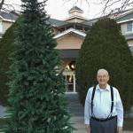 Resident Ralph Ireland enjoys the privileged position of being the first resident to have their picture taken with the tree.