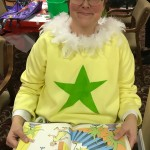 HR Director, Traci Wood dawns her wonderful costume of the Yellow Bellied Sneetches from the Dr. Seuss book The Sneetches.