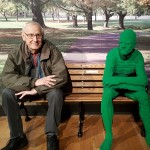 Resident Ted Scott poses next to the Green Man in the park...can you tell them apart?