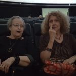 (Left-to-Right): Mary Louise Taylor and Marianne Schrik at the Planetarium discussing the amazing experience from their first showing of Phantom of the Universe and they were most impressed on how the Universe was projected on the ceiling...astonishing...to say the least!