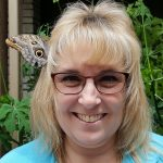 Rhonda Holler became the resting place for a Blue Morpho to rest...for nearly 45 minutes.