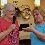 Judith Standly and Rhonda Holler. Judith enjoyed singing a song from one of her beloved vocalist, Doris Day's, Que Sera Sera!