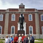 The Residents at the Harry S. Truman Statue at the Independence Courthouse. Pictured: (left-to-right) Alta Short, Muriel Langewisch, Jennie Woolworth, Jeanie Watson, Sharon Craney, Dorothy Short, Marie Moss, and Deanna Bates.