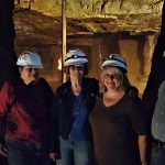 (Left-to-Right): Rhonda Holler, Deanna Bates, Pat Taylor, Karol Swain, and Richard Brown pose next to the opening that shows the 150 ft pump pipe that keeps the water levels where they need to be.