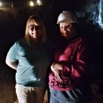 (Left-to-Right) Rhonda Holler and Deanna Bates pose on the second level of the mine dig.